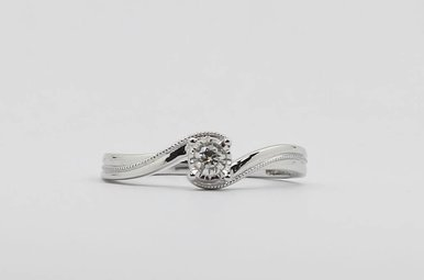Sterling Silver 1/10ctw Diamond Solitaire Ladies Promise Ring