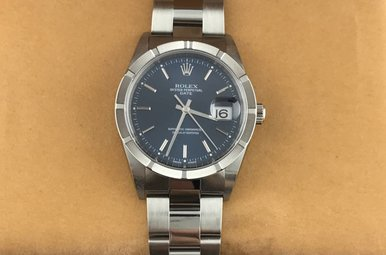 Rolex Stainless Blue Dial Engine-turn Bezel Watch (Pre-Owned)