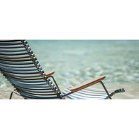 CLICK LOUNGE CHAIR WITH MULTI COLOR POLYPROPYLENE PLASTIC SEAT AND BACK, POWDER COATED STEEL FRAME AND BAMBOO ARM RESTS.
