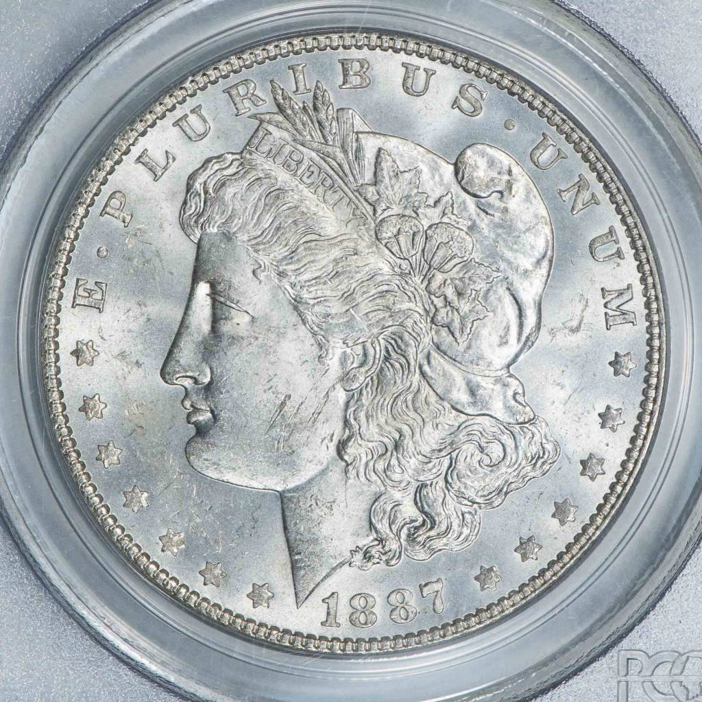 1887/6 PCGS MS63 Morgan Silver Dollar