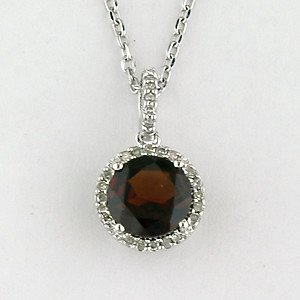 N0195G Garnet and diamond halo pendant necklace