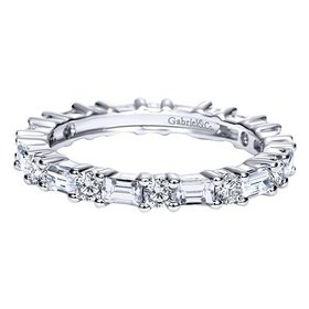 Alternating baguette and round diamond eternity band