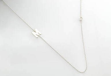 Freedman Small Initial Necklace attached to chain