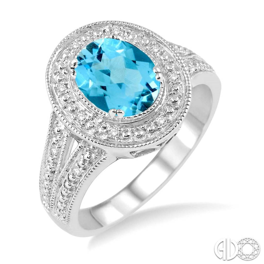 Ashi 9x7 MM Oval Cut Blue Topaz a and 1/20 Ctw Round Cut Diamond Ring in Sterling Silver