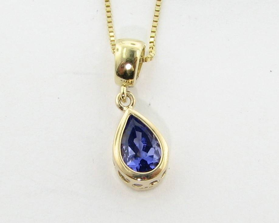 Tanzanite yellow gold pendant drop wexford jewelers sleek tanzanite yellow gold pendant drop aloadofball Image collections