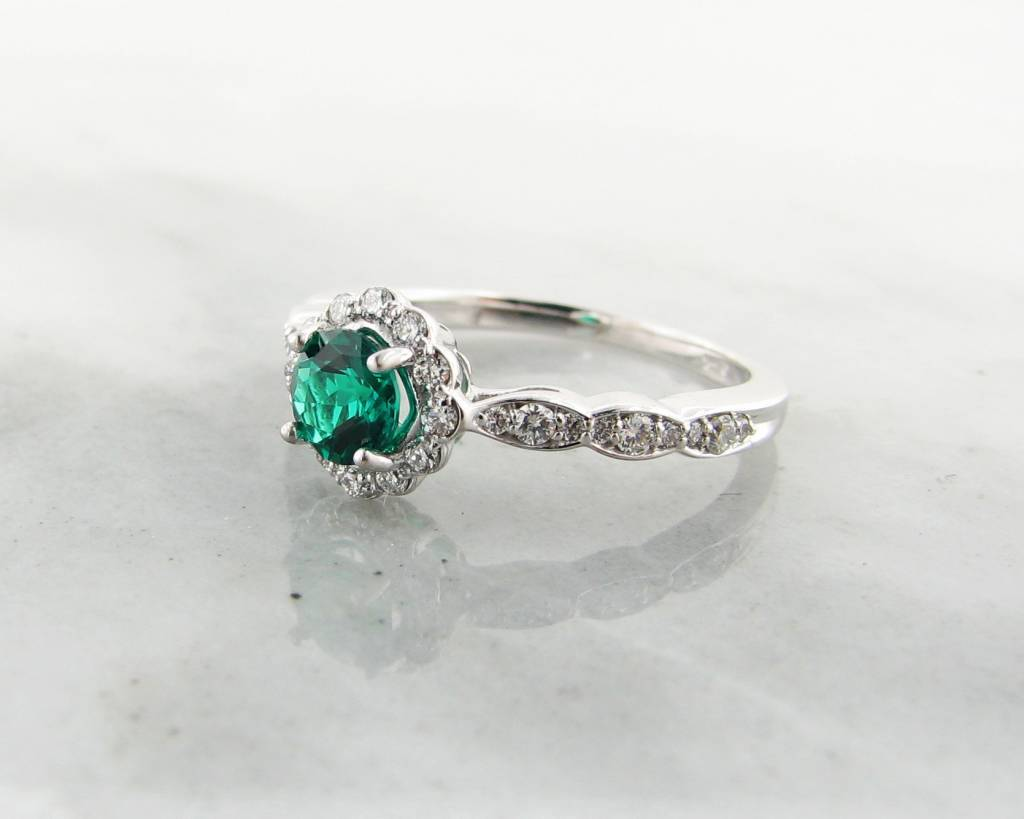 Trending Bridal Emerald and Diamond Halo White Gold Engagement Ring
