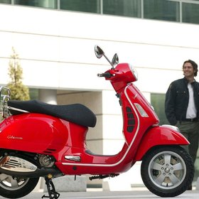 Vehicles 2009 Vespa GTS250 Red (Stock Photo Used)