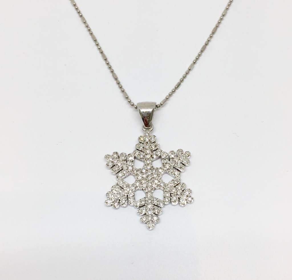 in white pendant yellow gold snowflake