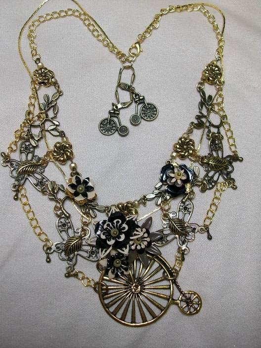 Sharon B's Originals Ant. Gold Unicycle Pendant w/ Black & Tan Flowers w/Earrings