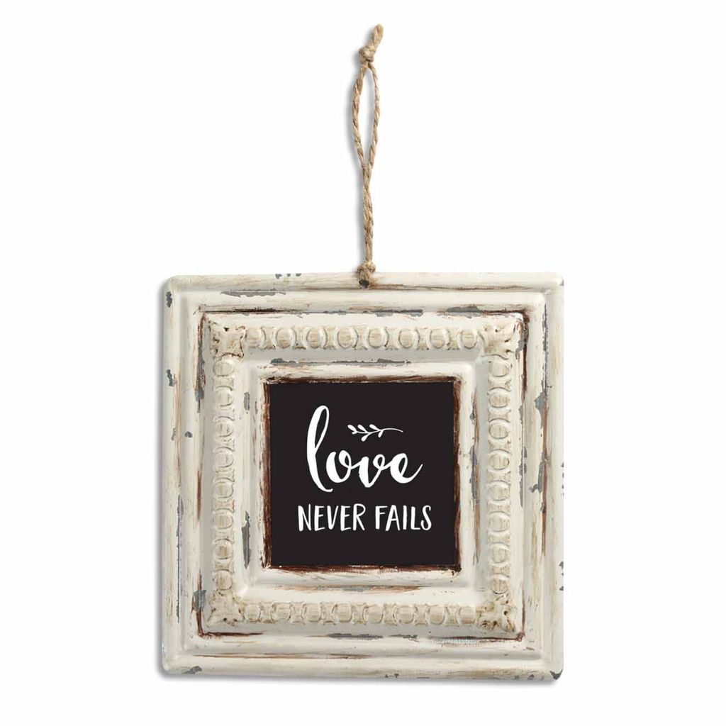 Love Never Fails Tin Sign