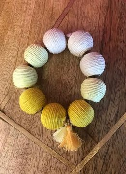 Shades of Yellow Cord Wrapped Ball Bracelet With Tassels