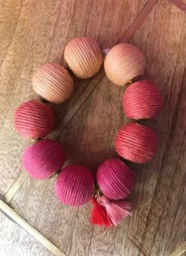 Shades of Pink Cord Wrapped Ball Bracelet With Tassels