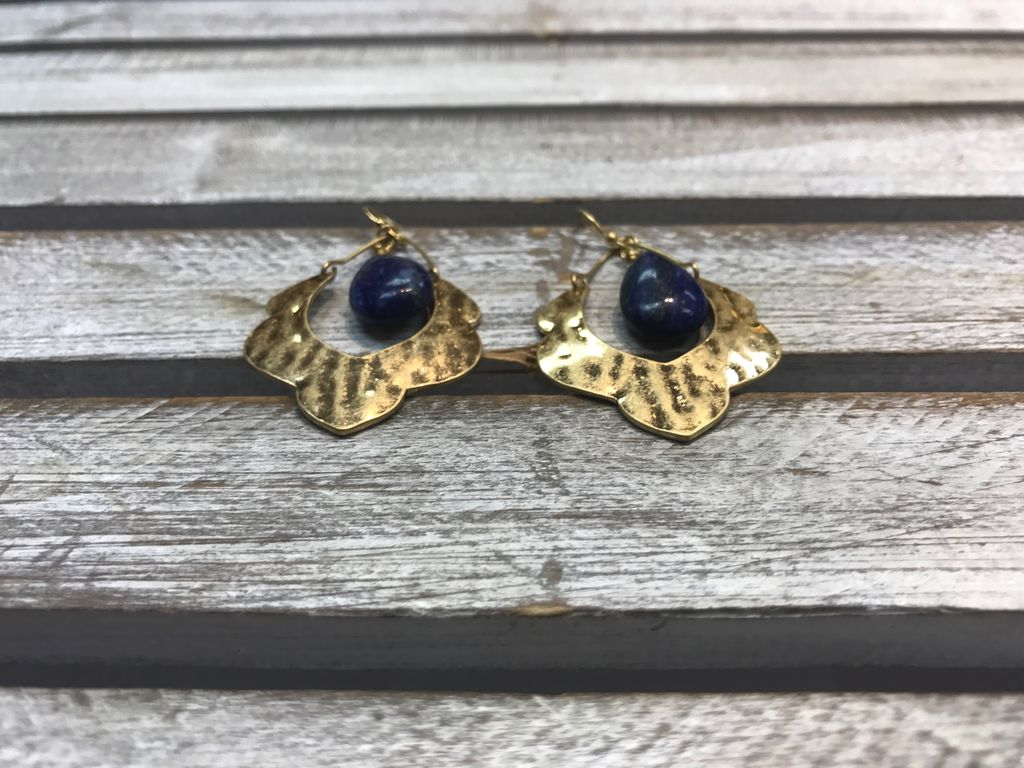 Gold Earrings with a Blue Stone Dangling in Middle