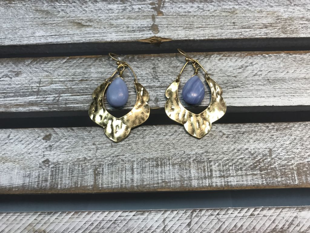 Gold Earring with a Light Blue Stone in the Middle