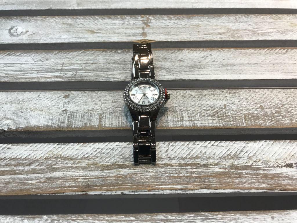 Dark Silver Watch with Rhinestones Around It