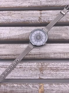 Silver Watch with Wide Face and Thin Band