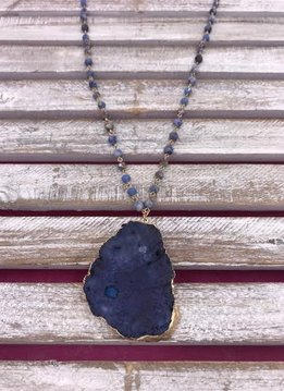 Long Gold Necklace with Blue Beads and a Blue Stone Pendant