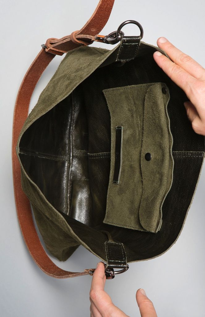 ELK Mr Elks Olijf Reversible Leather Tote has been handmade using thick, raw cow hides dyed using natural vegetable pigment. Rectangle in shape, it is reversible giving the option of a suede or leather look. A small pocket is available for your phone or small