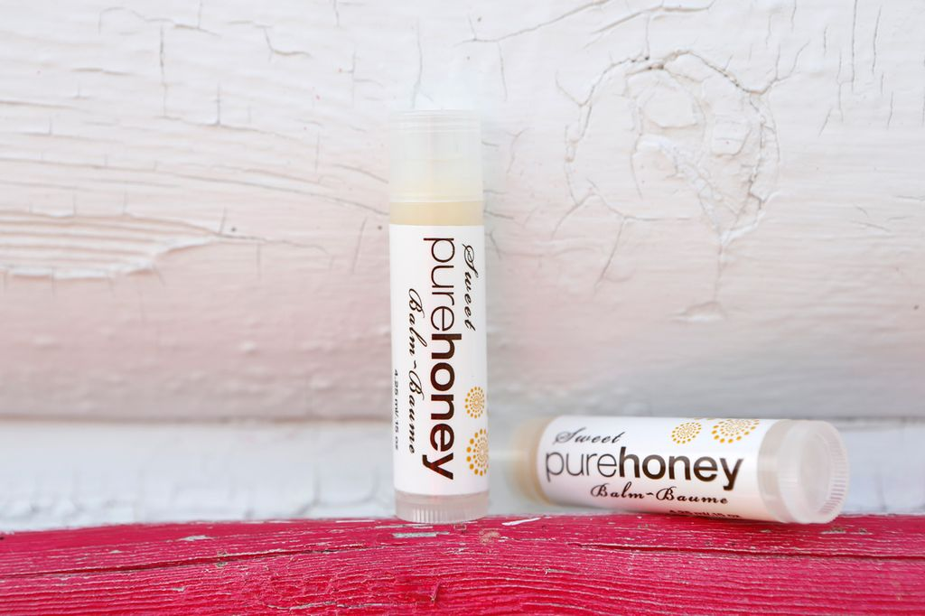 Pure Sweet Honey Hand crafted in small batches<br /> We hand pour, and label all our natural balms<br /> Using organic coconut oil, raw and filtered 100% beeswax we create our signature lip balm
