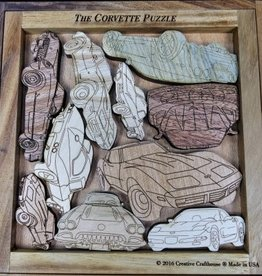 Collectibles Laser Cut Corvettes in wooden frame.