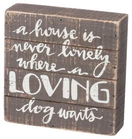 Sign-Loving Dog Waits