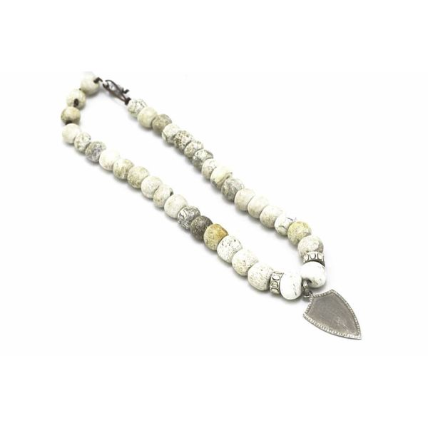 Ox Silver Shield on Fossil Stegadon Bone Necklace