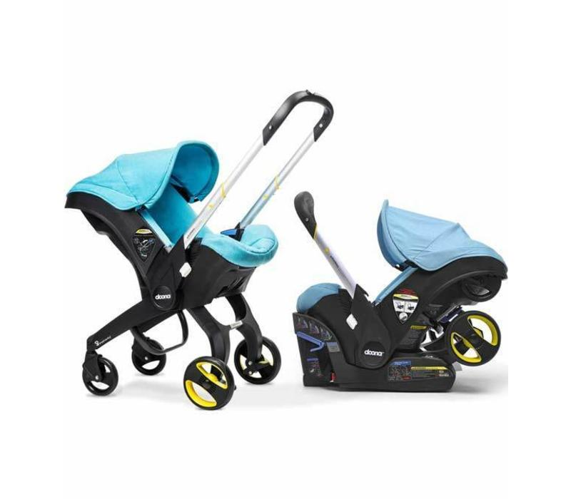 CLOSEOUT!! Doona Infant Car Seat - Stroller With Infant Car Seat Base Turquoise- Sky