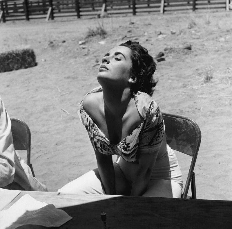 """Elizabeth Taylor sunning herself while on location in Marfa, Texas for the film """"Giant"""" 1955 - Sid Avery"""