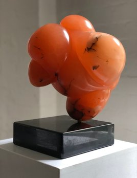Regina - Carol Crawford Sculpture - Translucent Orange Alabaster (USA) on a Black Granite Base