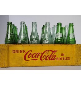 Coke crate with assorted pop bottles