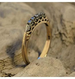 14kt yellow gold ring set with five small diamonds
