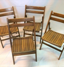 Set of four folding wooden chairs