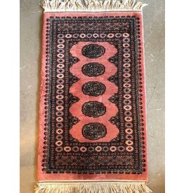 Rose coloured Bokhara carpet