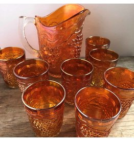 Marigold carnival glass pitcher & tumblers