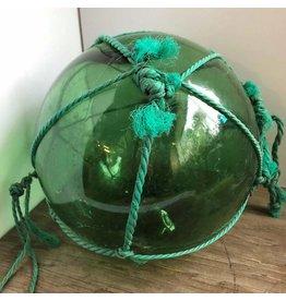 Glass float in netting