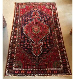 Rich red and blue Persian carpet