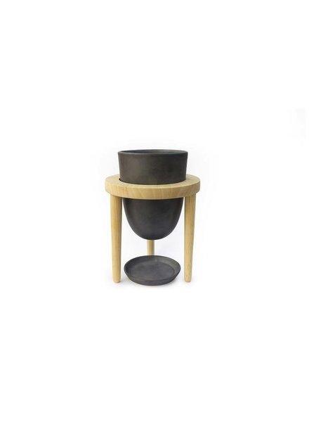 maceta mineral en base de madera color negro mate