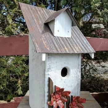 - N.C. RUSTIC BLUEBIRD HOUSE WHITE W/RED FLOWERS