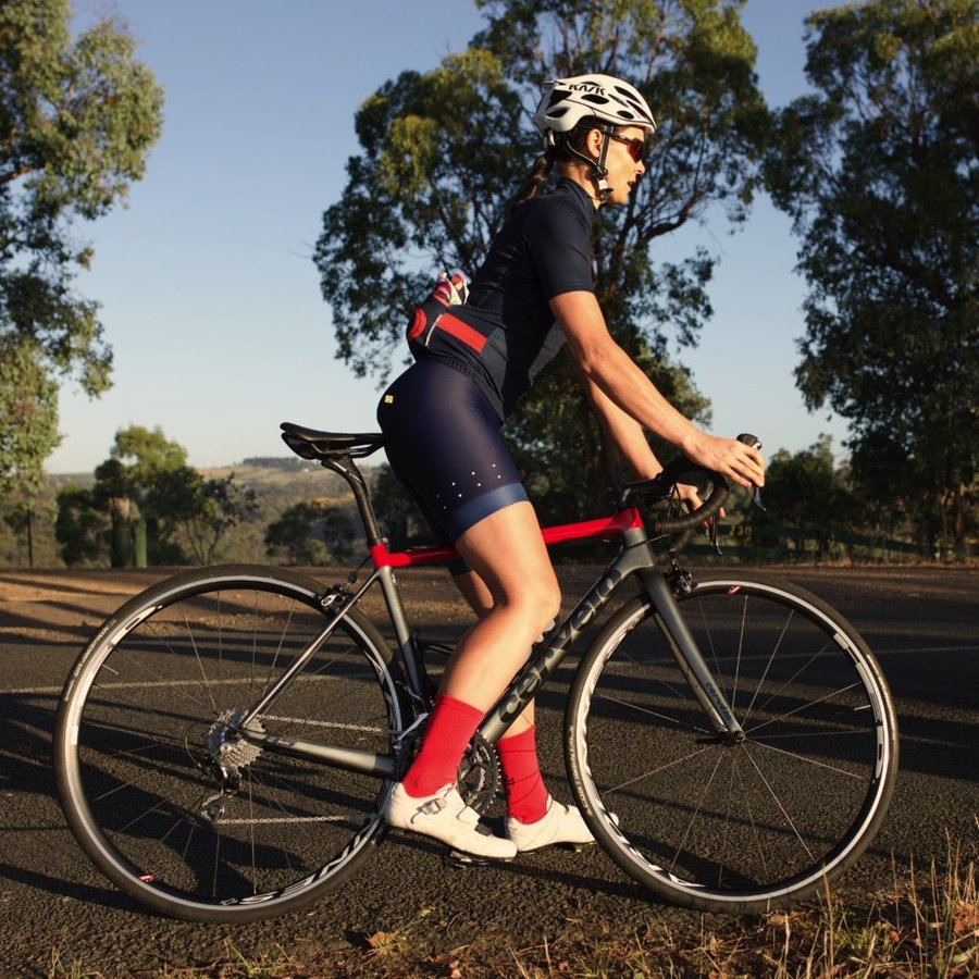 The Pedla - Full Gas - Pro race cut short sleeve women's specific jersey with Extended Sleeve Length is anatomically shaped to fit closly to the body. Constructed from a  super lightweight Dimple Dry Aero fabric, this set-in-sleeve jersey uses the latest