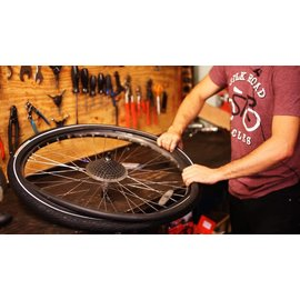 Install tire or tube on bike (per wheel plus tube)