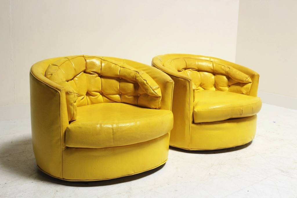 PAIR OF YELLOW LEATHER SWIVEL CHAIRS