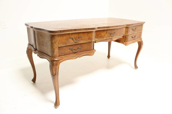 BENT KNEE BURL DESK