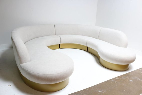 CURVY SOFA WITH PAINTED PLINTH BASE