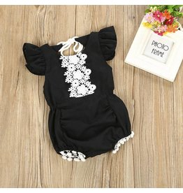 Black Romper with White Eyelet Lace and Pom Poms