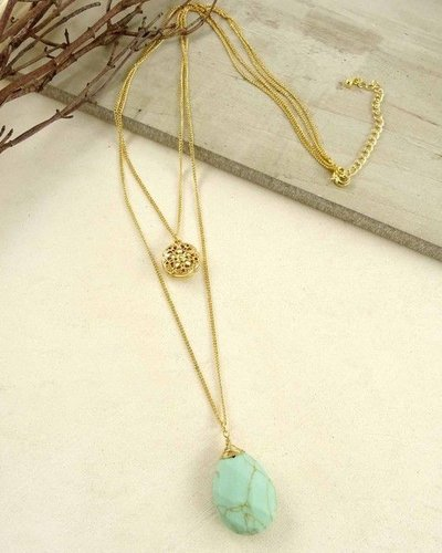 Layered necklace with flower pendant and turquoise stone