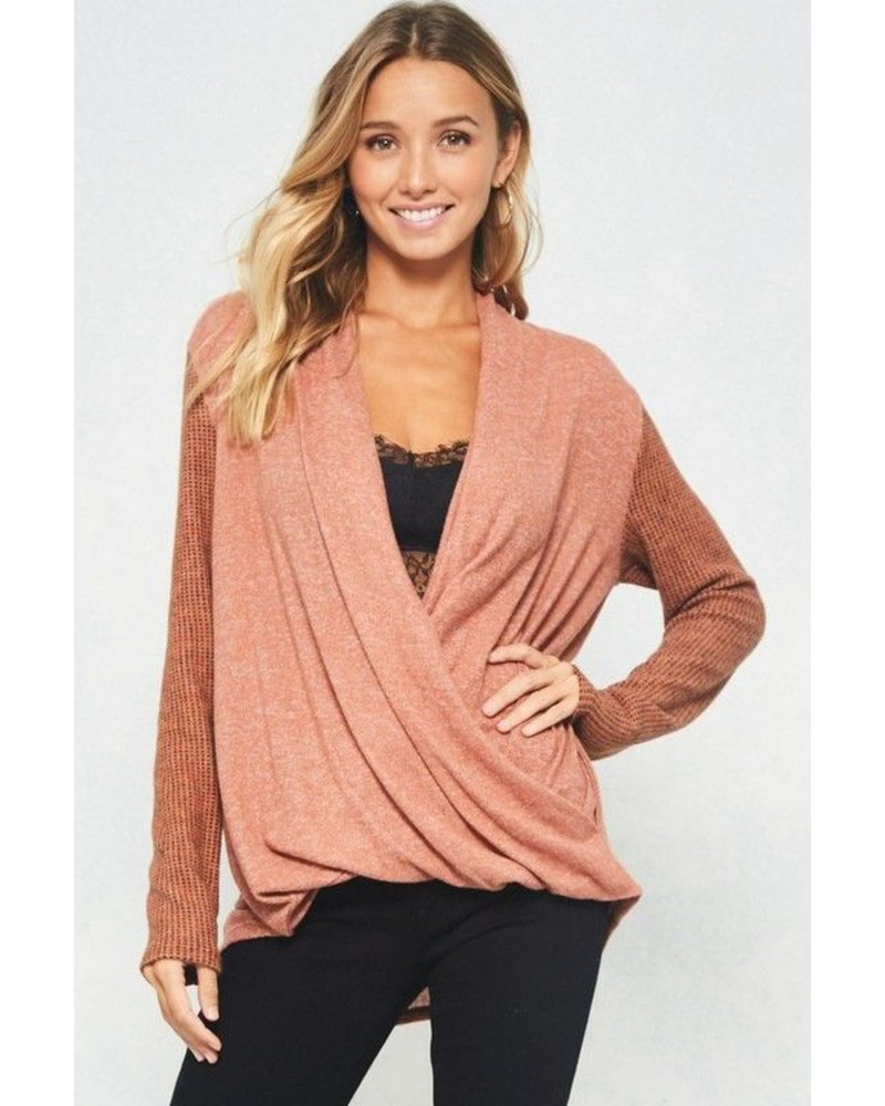 Knit top featuring surplice front