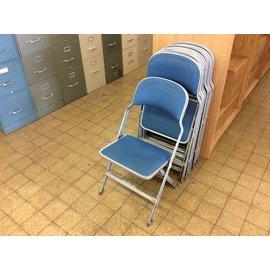 Blue padded metal frame folding chair