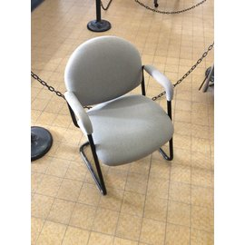 Grey padded side chair with arms