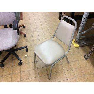 Tan padded metal frame kitchen chair