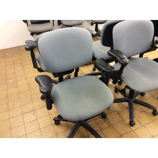 Blue desk chair with retractable arm rests (small stain)